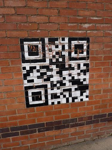 A QR code on a brick wall